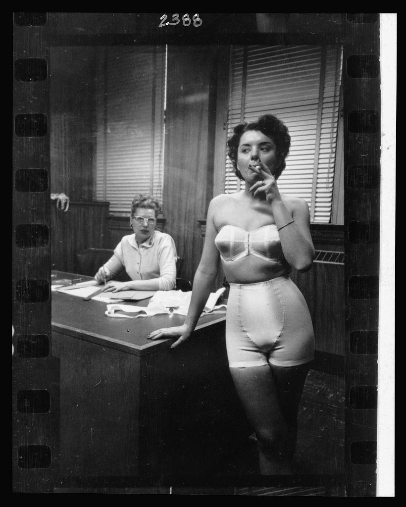 Lingerie model smoking in an office, © Stanley Kubrick, 1949