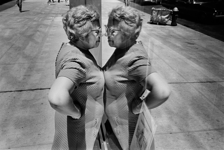 Richard Kalvar: USA. New York City. 1969. Woman looking at herself in store window.